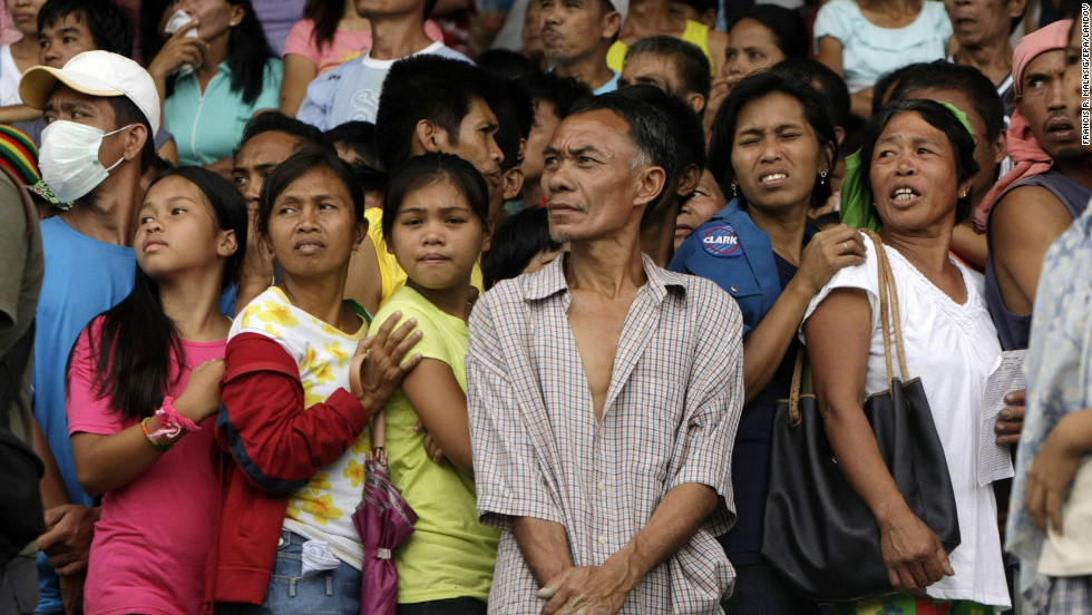A crowd of Filipino flood victims wait for relief goods inside a sports complex that has been turned into a temporary evacuation center in New Bataan, Compostela Valley, on December 7.