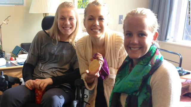 Mallory Weggemann  (right) shows off the Paralympic gold medal she won at London 2012.