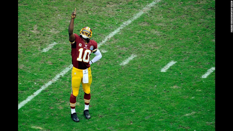 Quarterback Robert Griffin III of the Washington Redskins celebrates after Alfred Morris scored a touchdown against the Baltimore Ravens at FedExField on Sunday, December 9, in Landover, Maryland.