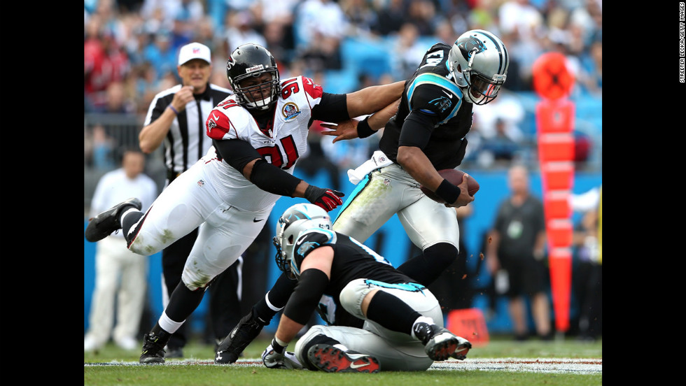 Panthers quarterback Cam Newton breaks away from Corey Peters of the Falcons on Sunday.