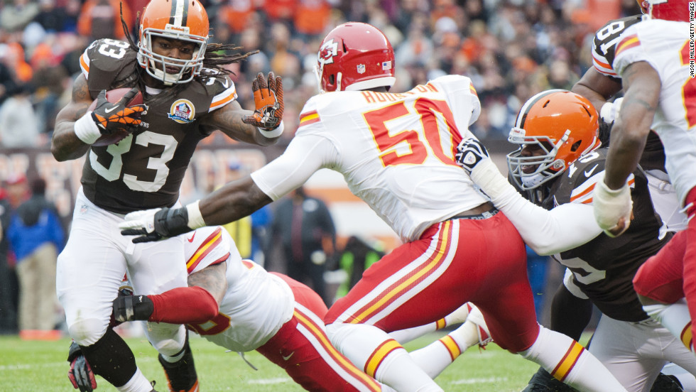 Running back Trent Richardson of the Browns is tackled by Chiefs linebackers Derrick Johnson and Justin Houston during the first half on Sunday.