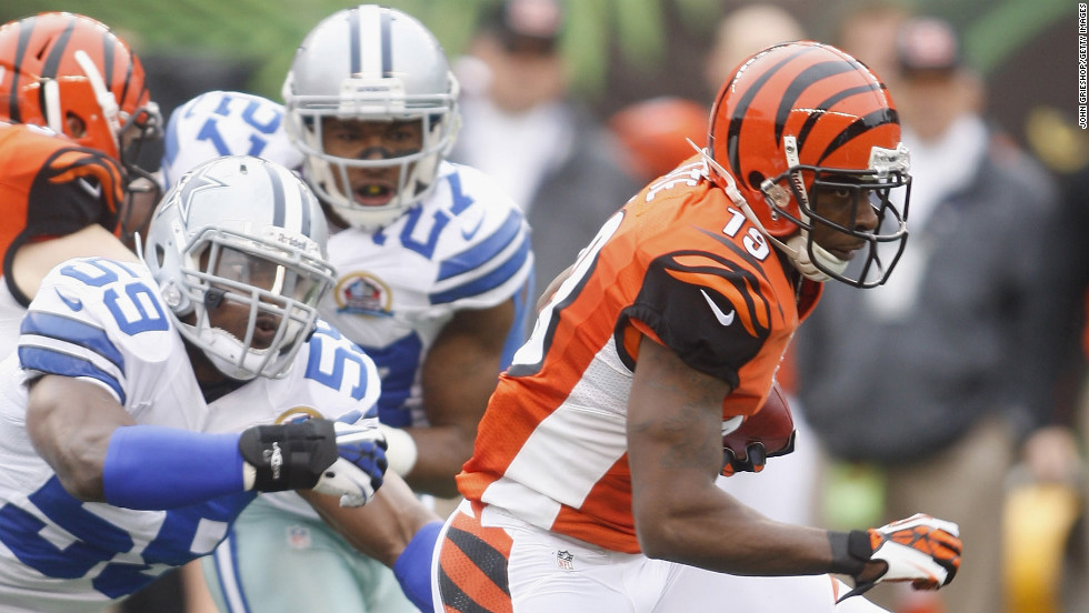 Bengals wide reciever Brandon Tate runs the ball upfield against the Cowboys on Sunday.