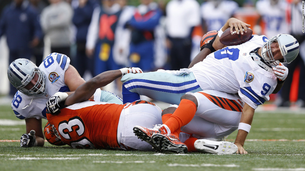 Michael Johnson and Carlos Dunlap of the Bengals team up to sack Cowboys quarterback Tony Romo on Sunday.