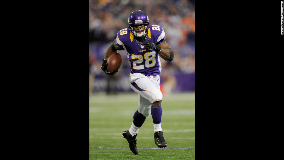 Adrian Peterson carries the ball during the first quarter against the Bears on Sunday.