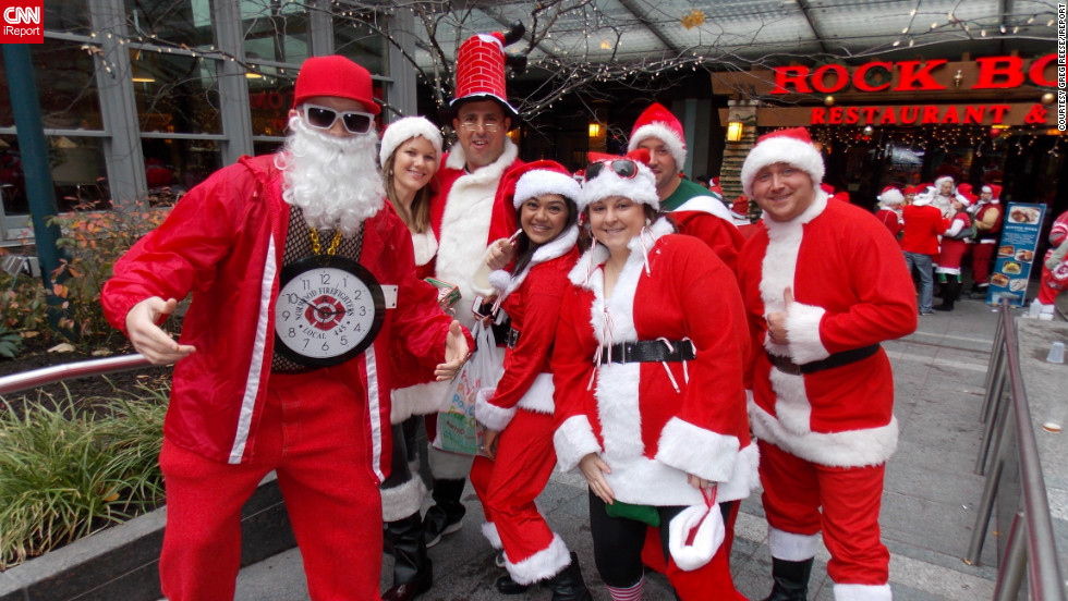 "<a href="" http://ireport.cnn.com/people/gregreesehd"">Greg Reese</a> photographed these costumed attendees of Santacon 2012 in Cincinnati, Ohio. ""It's an annual event where they dress up like Santa and other holiday icons and walk around the city giving candy and [going on] pub crawls,"" he said."