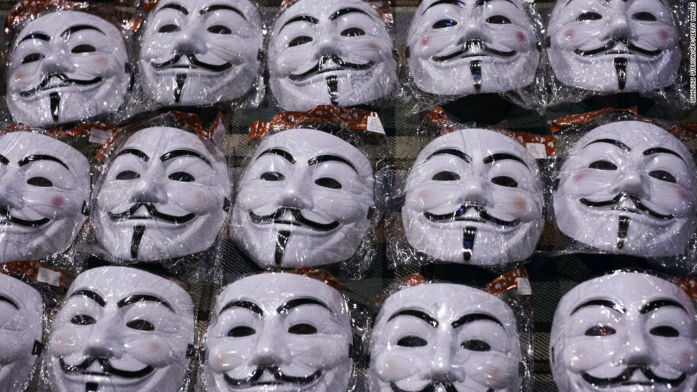 Guy Fawkes masks are displayed by a street vendor in front of the Egyptian presidential palace in Cairo on December 9. The masks depict Fawkes, a rebel executed in England's Gunpowder Plot seeking to blow up the House of Lords in the early 1600s.