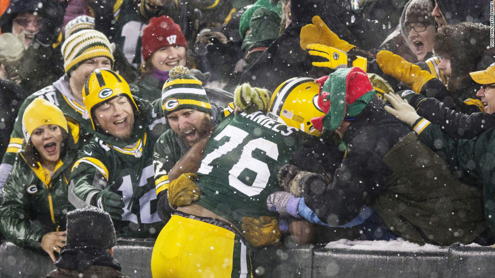 "Mike Daniels of the Green Bay Packers does a ""Lambeau Leap"" after he scored a touchdown on a fumble recovery on Sunday."