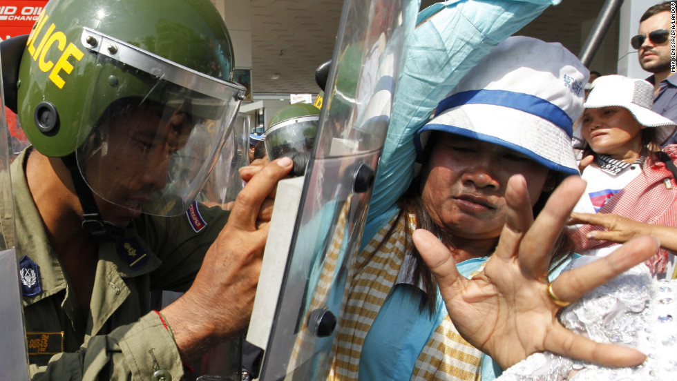Cambodian demonstrators clash with police officers after a peaceful march in Phnom Penh, Cambodia, on December 10.