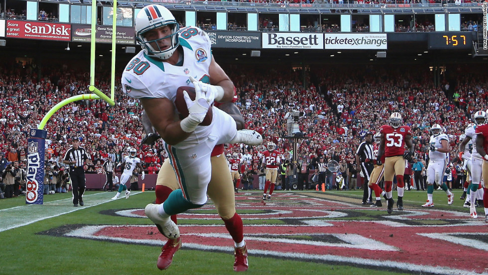 Miami Dolphins tight end Anthony Fasano makes a diving catch for a touchdown against the 49ers on Sunday.