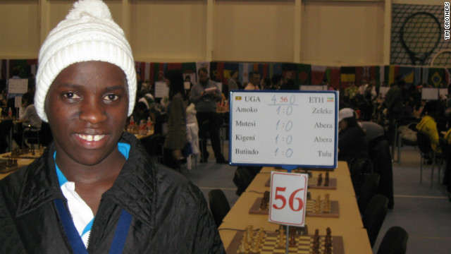 Ugandan chess sensation Phiona Mutesi relishes her first victory at the 2010 Chess Olympiad in Khanty-Mansiysk, Russia