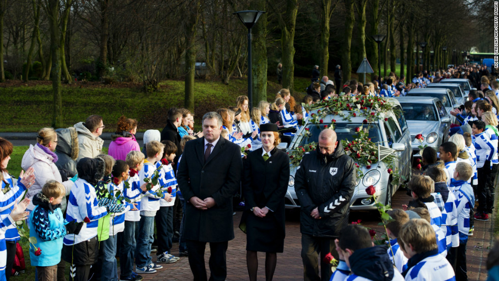 Members of Dutch football club SC Buitenboys pay respect to Richard Nieuwenhuizen as the hearse carrying his body arrives at the crematorium in Almere on December 10.