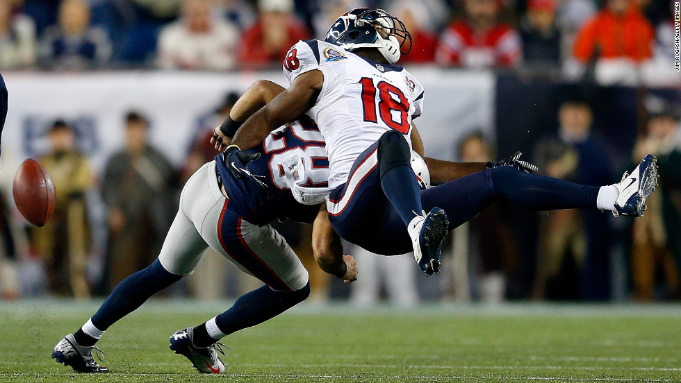 Steve Gregory of the New England Patriots breaks up a pass intended for Lestar Jean of the Houston Texans on Monday.
