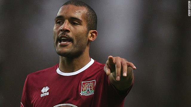 Clarke Carlisle in action playing for Northampton Town in 2012.