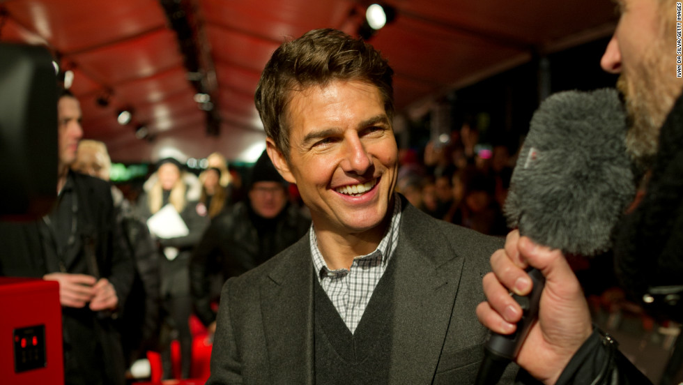 "Tom Cruise smiles while chatting on the red carpet at the premiere of ""Jack Reacher"" in Stockholm, Sweden, on December 11."
