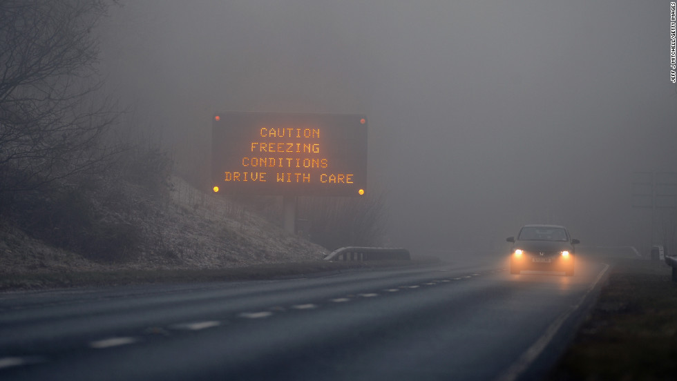 A car drives on the A82 past a road traffic sign on December 12 in Loch Lomond, Scotland.