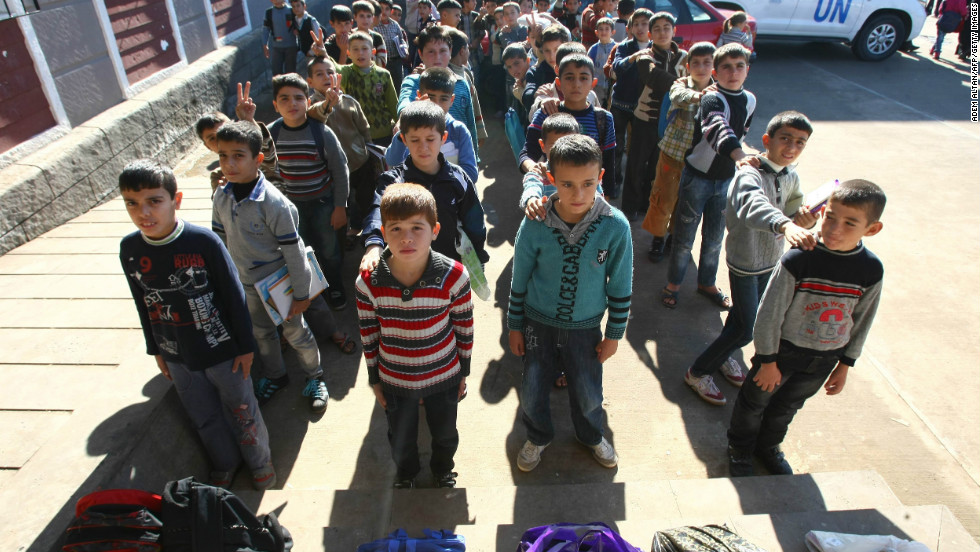 Syrian refugee children wait to enter their class on November 27, 2012 in the Oncupinar camp in Kilis, southern Turkey.