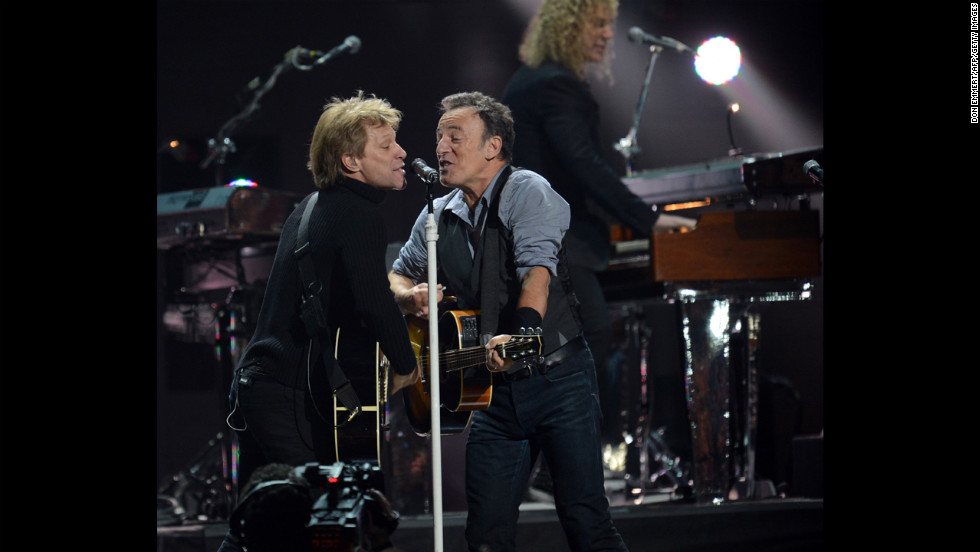 "Jon Bon Jovi, left, and Bruce Springsteen shared the mic to raise money for victims of Hurricane Sandy. ""This recovery is not going to be quick,"" Bon Jovi told the crowd during his set. ""We need your support."""