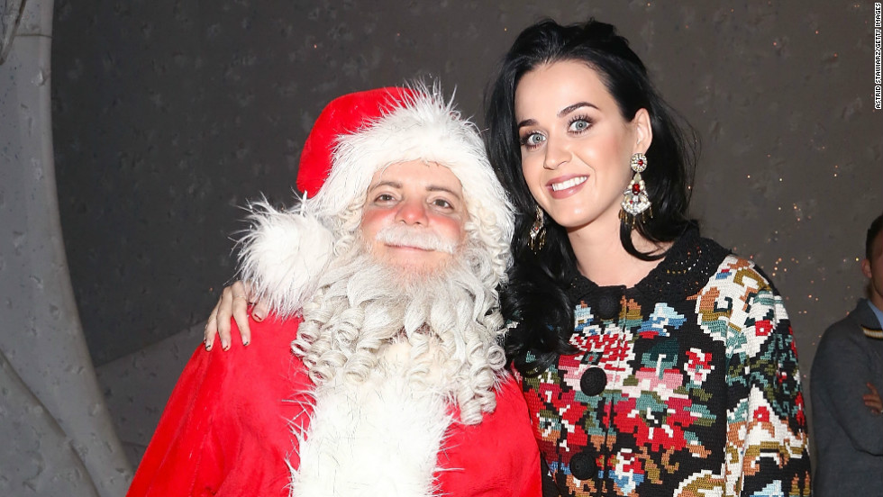 "Katy Perry stops for a photo with Santa from the Broadway performance of ""A Christmas Story, The Musical"" on December 12."