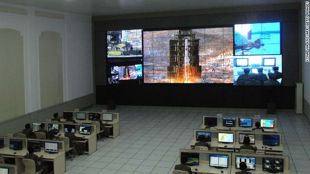 This picture from North Korea's Korean Central News Agency on December 12 shows the rocket Unha-3 being monitored at a satellite control center in North Korea.