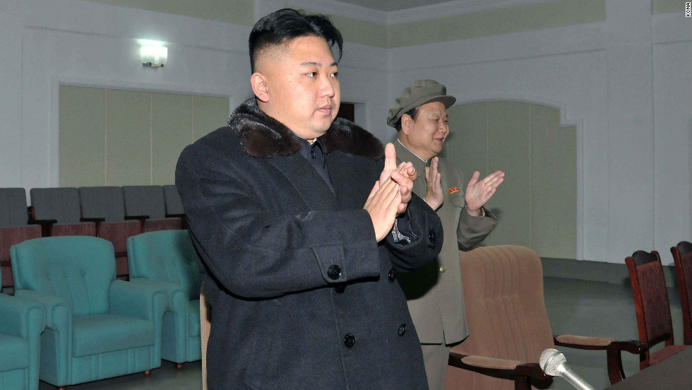 Kim rises to applaud the successful launch, a big technological victory for North Korea in the wake of an embarrassing failed launch in April.