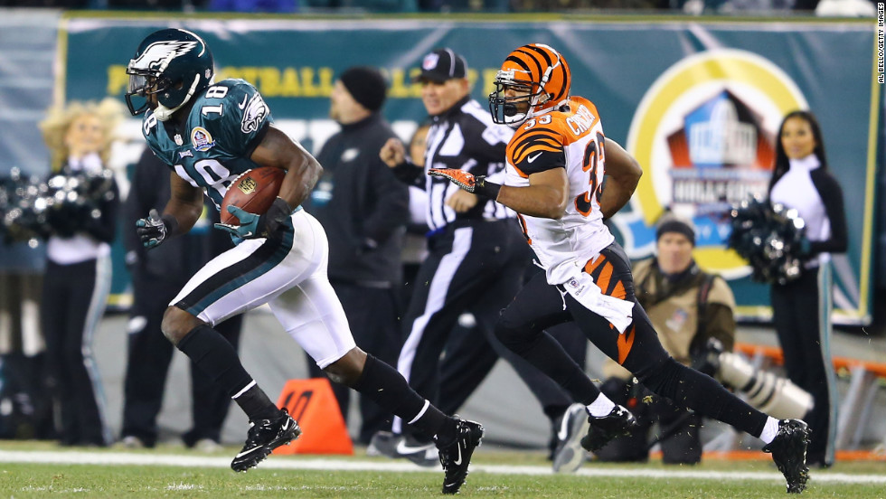 Jeremy Maclin of the Philadelphia Eagles runs after making a catch while he is pursued by Chris Crocker of the Cincinnati Bengals during their game on December 13.