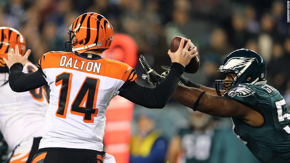 Brandon Graham of the Philadelphia Eagles knocks the ball from Andy Dalton of the Cincinnati Bengals on Thursday, December 13, at Lincoln Financial Field in Philadelphia.