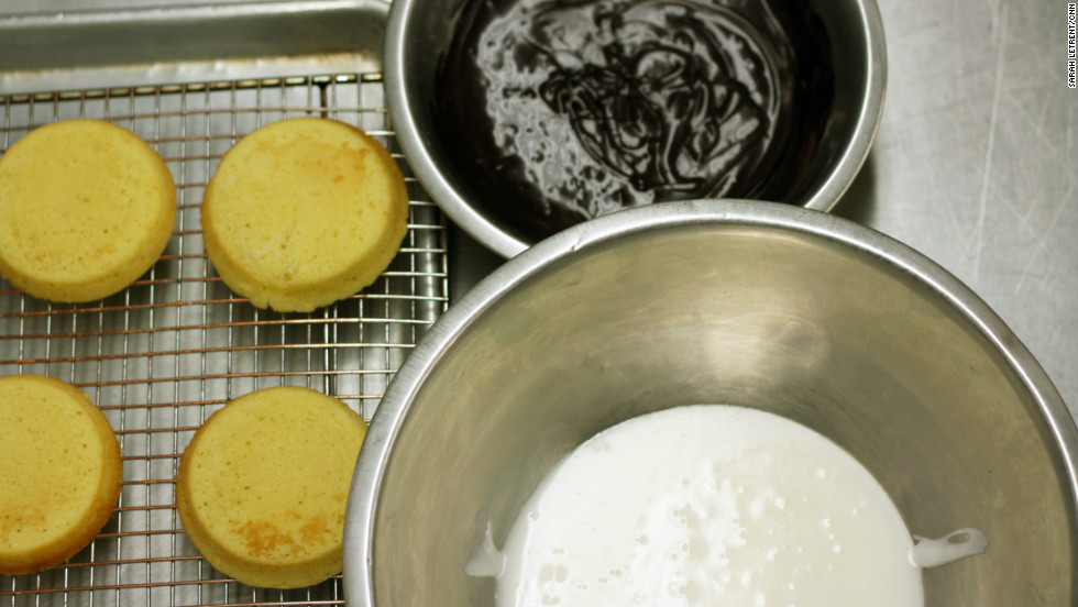 While the cookies are cooling after baking for 15-20 minutes, whisk together 1/2 lb confectioners' sugar, 1/2 lb cocoa and 1 cup milk for the chocolate glaze. In another bowl, whisk together 1 lb confectioners' sugar and 1/4 cup milk for the vanilla glaze. If the icing gets too thick, add extra milk or water until it's more spreadable.