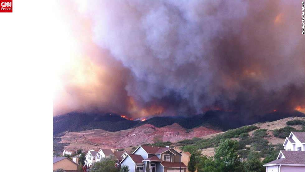 "Wildfires burning in the foothills of the <a href=""http://ireport.cnn.com/docs/DOC-807852"">Colorado Springs mountains </a>blanketed a nearby neighborhood with pitch-black smoke in June. ""We ran outside and saw the side of the foothills getting engulfed by flames coming down on either sides of the quarry,"" said photographer Michael Kennedy. ""Our subdivision quickly deteriorated into a war zone with police cars coming into the neighborhood with loud speakers announcing 'leave the area, under mandatory evacuation.'"""