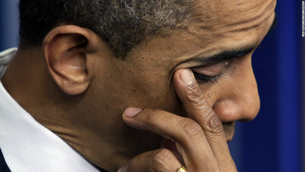 President Barack Obama wipes a tear as he speaks about the shooting at Sandy Hook Elementary School during a press briefing at the White House on December 14.