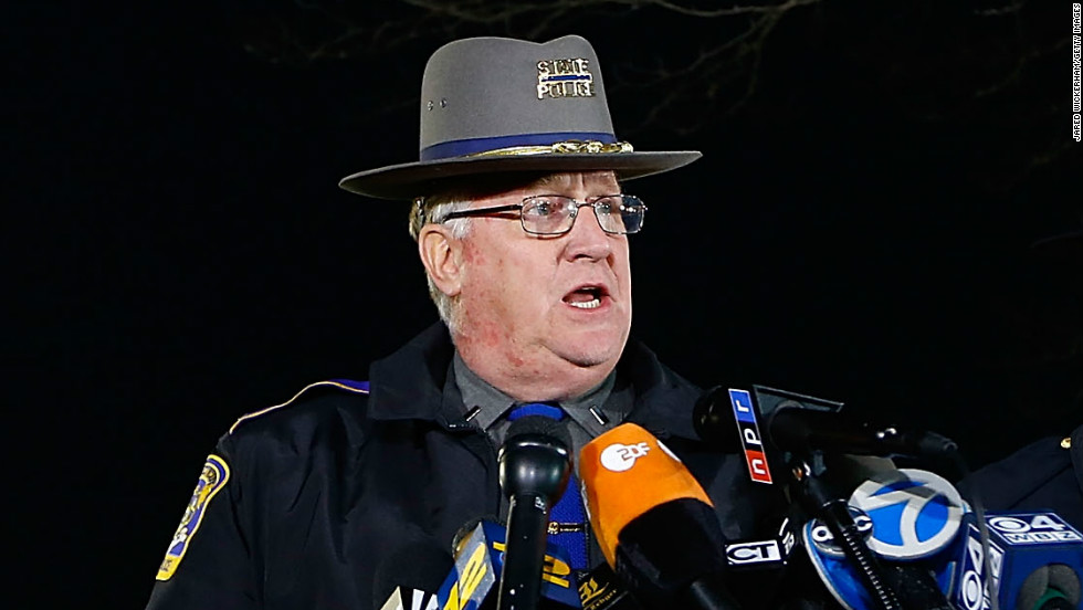 Connecticut State Police spokesman Lt. J. Paul Vance, center, briefs the media on the elementary school shootings during a press conference at Treadwell Memorial Park on December 14 in Newtown.