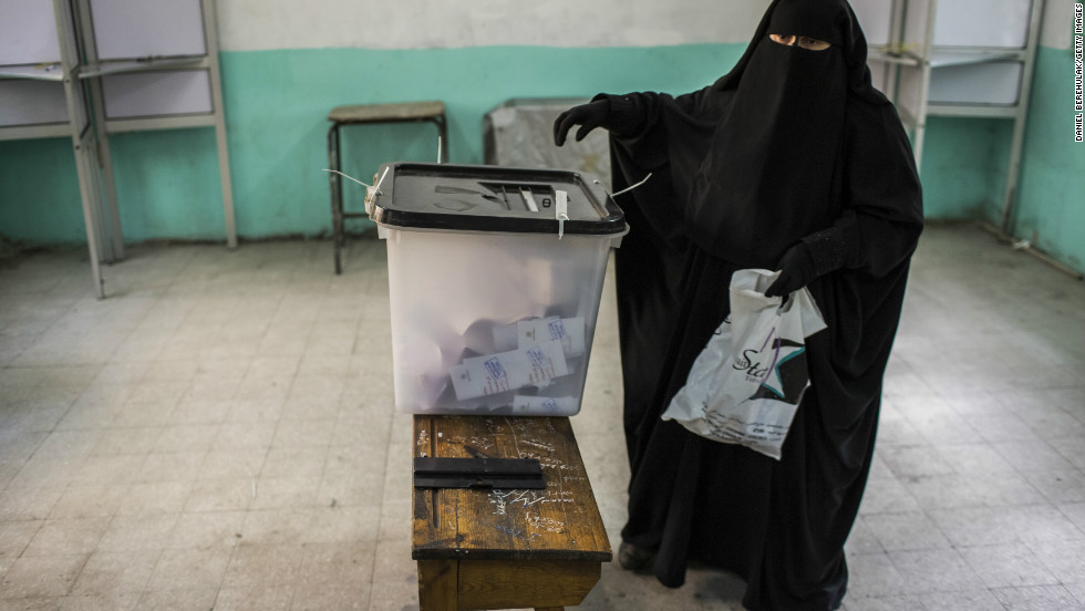 An Egyptian woman casts her vote during a referendum on the new Egyptian constitution on December 15, 2012 in Cairo, Egypt.