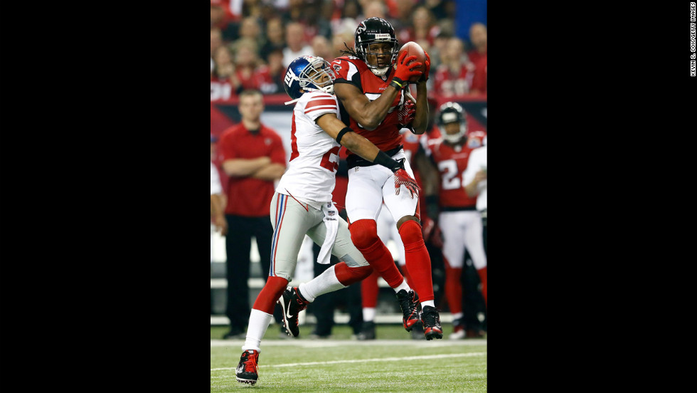 Roddy White of the Falcons pulls in this reception against Jayron Hosley of the Giants on Sunday.