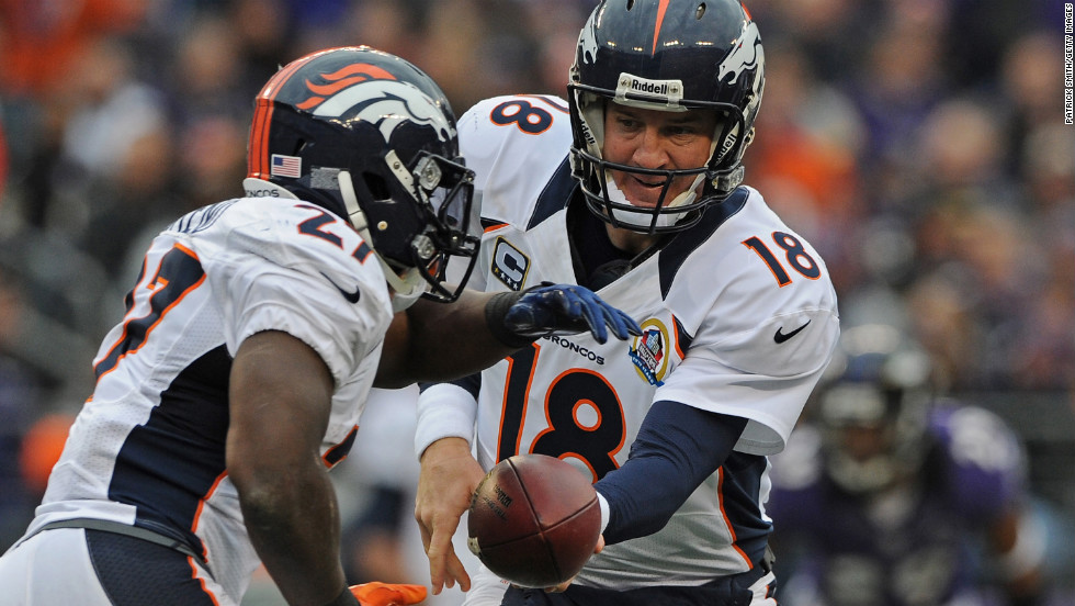 Quarterback Peyton Manning of the Broncos hands off to teammate Knowshon Moreno against the Ravens in the first quarter on Sunday.