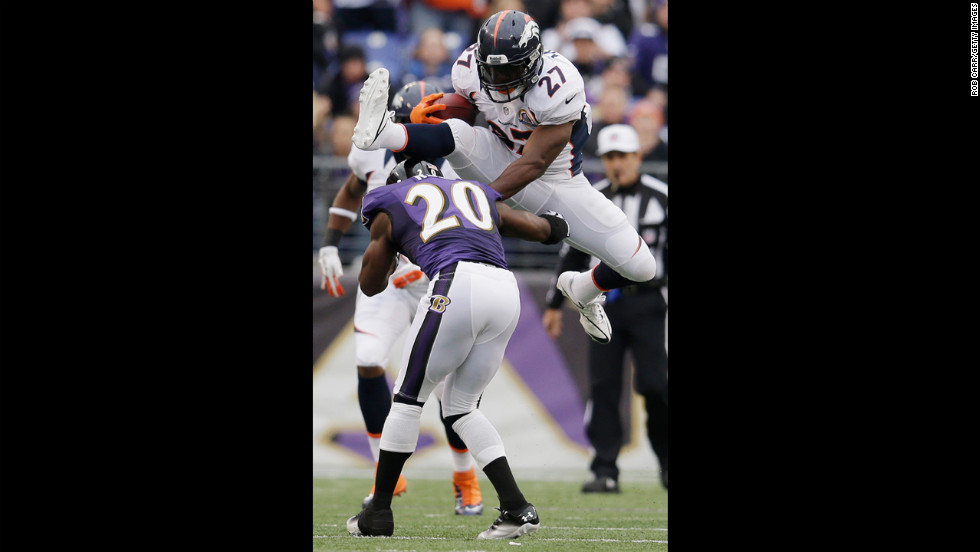 Running back Knowshon Moreno of the Broncos jumps over free safety Ed Reed of the Ravens while rushing the ball during the first half on Sunday.
