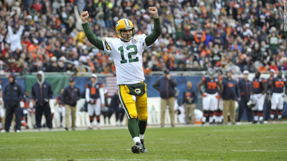 Aaron Rodgers of the Green Bay Packers reacts after throwing a touchdown pass against the Chicago Bears on Sunday at Soldier Field in Chicago.