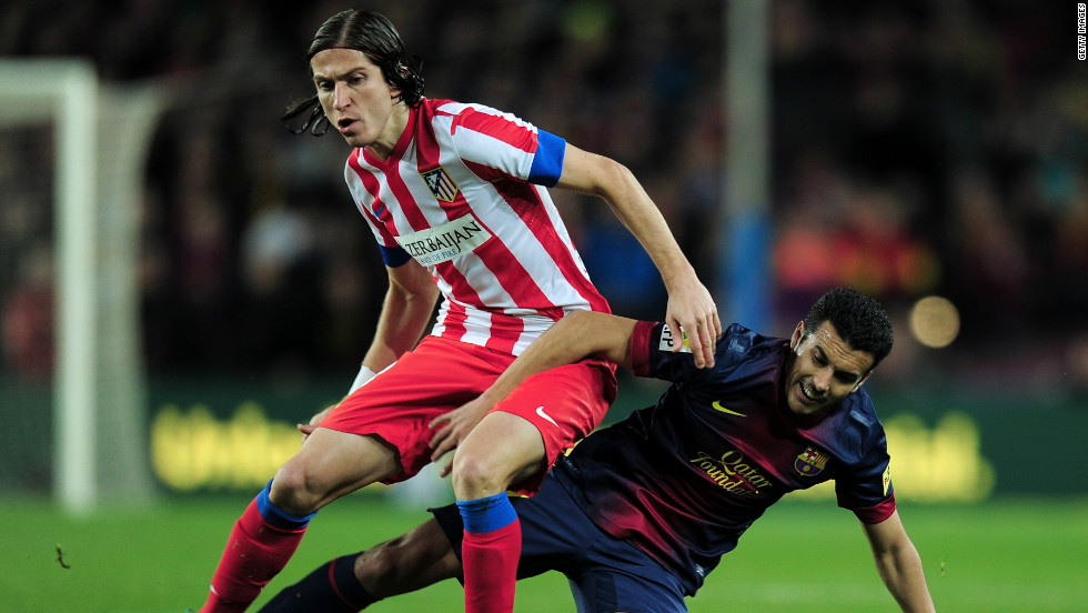 Barcelona's forward Pedro Rodriguez and Atletico's Filipe Luis go in for a challenge as La Liga's top two went head-to-head. Barca had taken an incredible 43 points from a possible 45, winning 14 of their 15 league games to lead Atletico by six points.