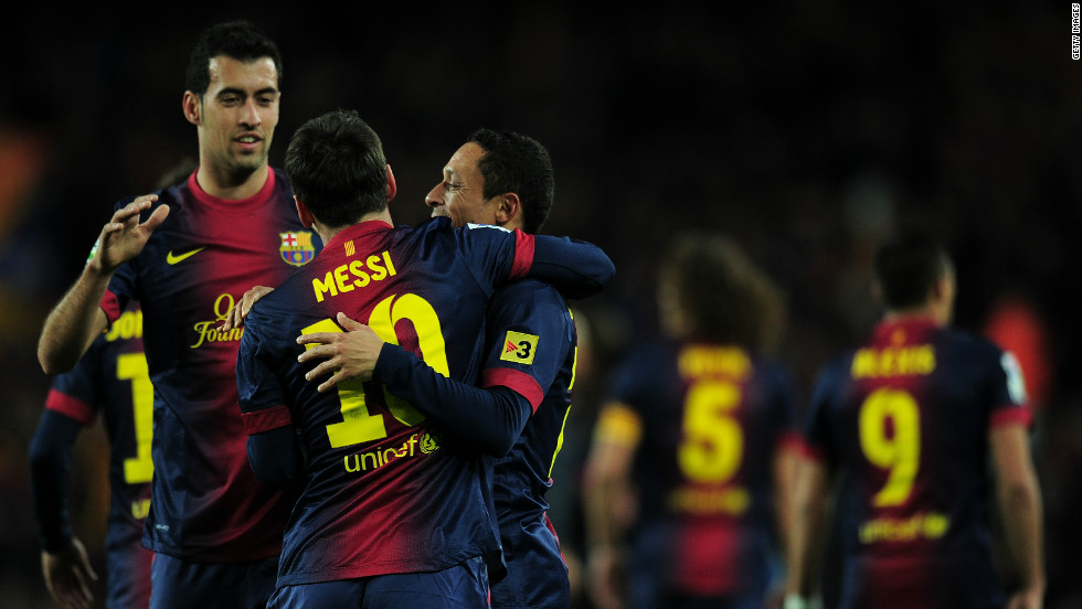 Messi celebrates with fellow goalscorers Busquets and Adriano as Barca move into a 3-1 lead at Camp Nou.