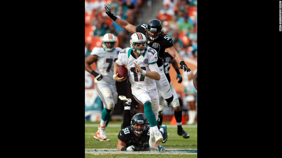 Quarterback Ryan Tannehill of the Dolphins scrambles against the Jaguars on Sunday.