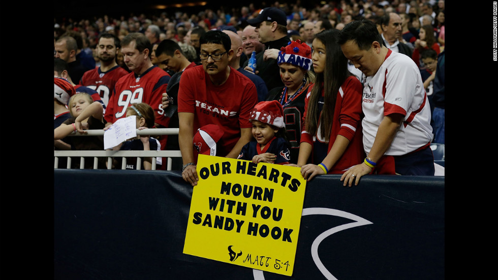 Texans fans take a moment to remember the victims of a massacre at Sandy Hook Elementary School in Newtown, Connecticut prior to the start of the game against the Colts on Sunday.