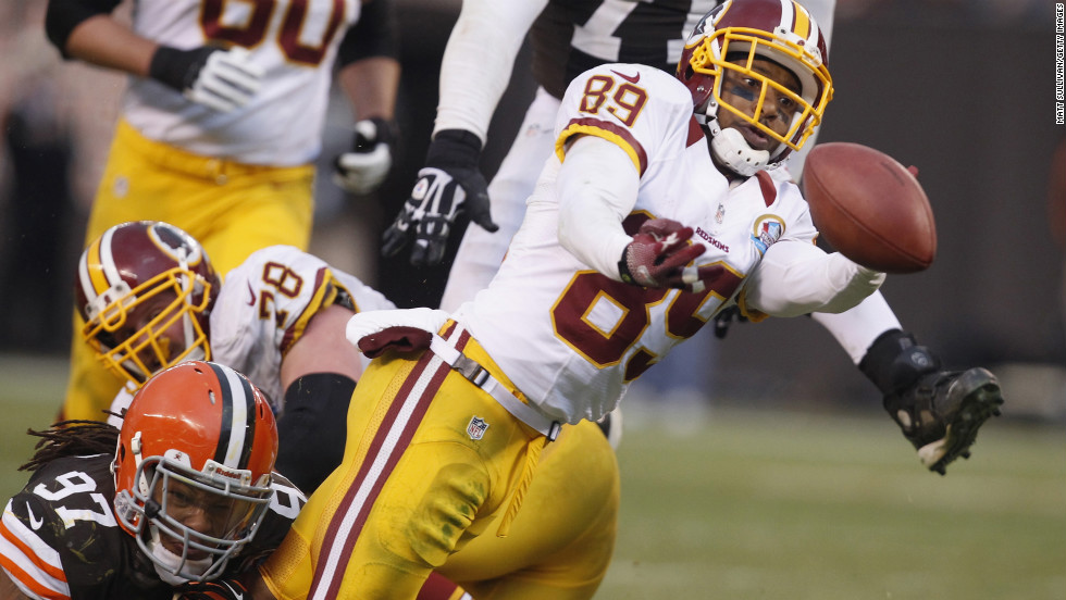 Wide receiver Santana Moss of the Redskins fumbles the ball as he is hit by defensive lineman Jabaal Sheard of the Browns on Sunday.