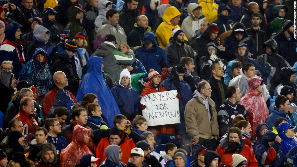 "A fan holds a sign that reads, ""Prayers for Newtown"" prior to the game between the San Francisco 49ers and the New England Patriots at Gillette Stadium on Sunday, December 16, in Foxboro, Massachusetts."