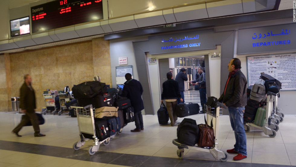 Passengers gather at a terminal at the airport in Aleppo, Syria, on Wednesday, December 12.