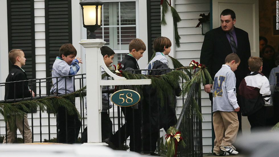 Boys enter Honan Funeral Home before Jack Pinto's funeral on December 17 in Newtown.