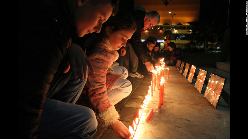 Children light candles to pay their respects to the victims of the Newtown, Connecticut, shooting at the main square in Tirana, Albania, on Monday, December 17. The deadly gun rampage at Sandy Hook Elementary School has provoked strong reactions from around the world.