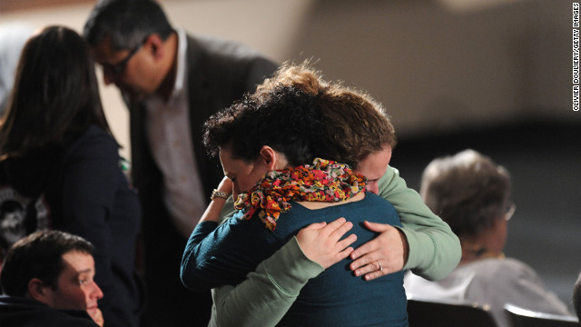 Mourners comfort one another at an interfaith vigil for the shooting victims on December 16.