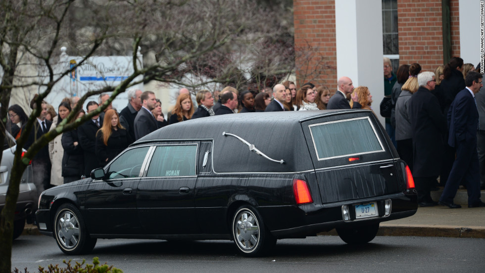 Jessica Rekos' casket arrives at St. Rose of Lima Roman Catholic Church as mourners gather December 18.