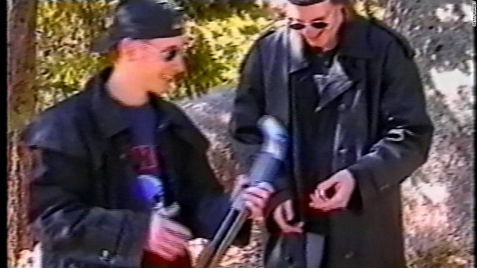 Columbine High School shooters Eric Harris, left, and Dylan Klebold examine a sawed-off shotgun at a makeshift shooting range March 6, 1999, in Douglas County, Colorado. A month later, the high school seniors opened fire on students and teachers in classrooms, the cafeteria and the library, killing 13 people and wounding 23 others.