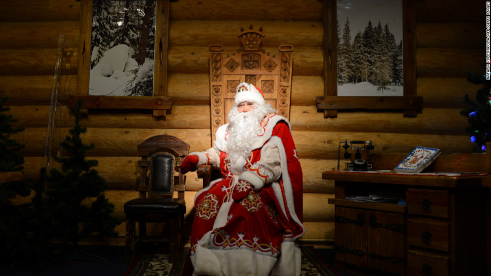 A man dressed as Ded Moroz, the Russian Santa Claus, entertains children at the Ded Moroz residence in Kuzminsky Park in Moscow on Tuesday, December 11.
