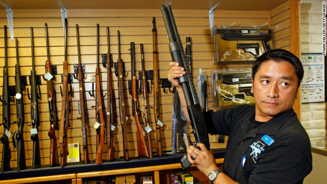 The Gun Store rangemaster Heu Thao shows a customer a shotgun November 14, 2008 in Las Vegas, Nevada. Store manager Cliff Wilson said he's seen a large spike in sales since Barack Obama was elected president on November 4, with customers citing fears about the president-elect's record on firearms.