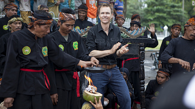 Phil Keoghan (center) hosting an episode of CBS' 'The Amazing Race' in 2012.